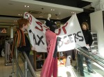 Tax Man hands out flyers inside Topshop