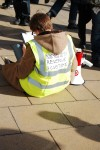 A BSRC officer does some calculations. Topshop didn't even give us a table and chairs to do them!